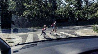children passing the street